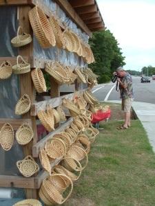 Robert Clark stands downwind of the baskets